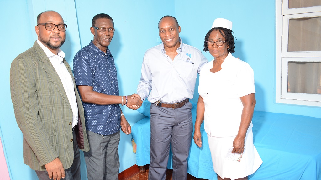 Noranda Bauxite's Vice President and General Manager Delroy Dell (2nd right), with St Ann's Bay Mayor Michael Belnavis (left), Councillor Dallas Dickenson (2nd left) and Matron of the St Ann Infirmary, Ity Vickers.