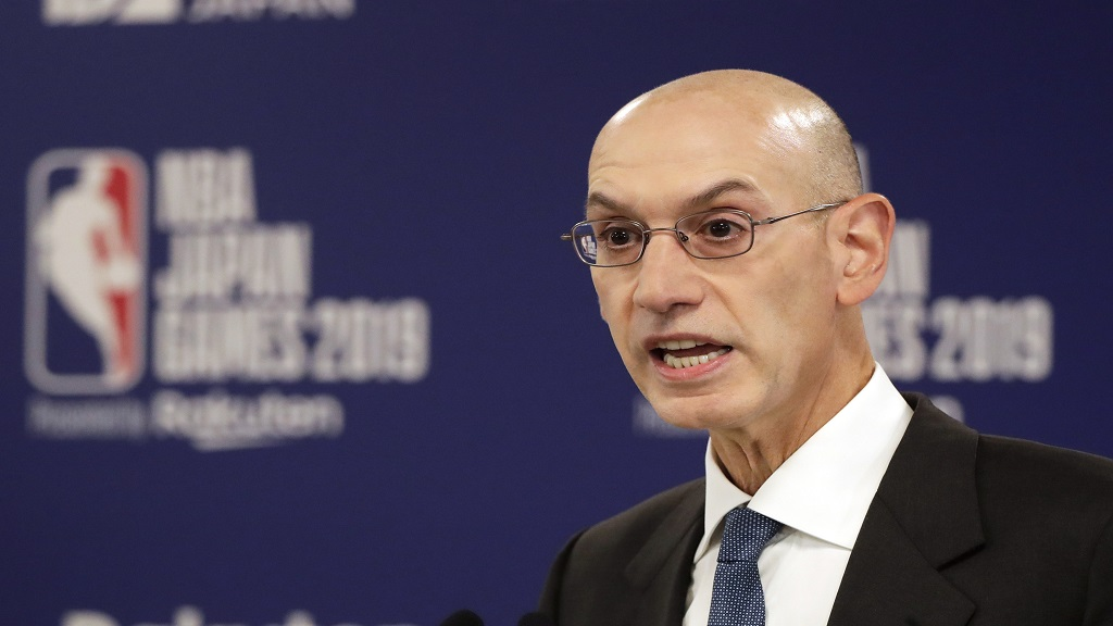 In this Oct. 8, 2019, file photo, NBA Commissioner Adam Silver speaks at a news conference before an NBA preseason basketball game between the Houston Rockets and the Toronto Raptors in Saitama, Japan. (AP Photo/Jae C. Hong, File).