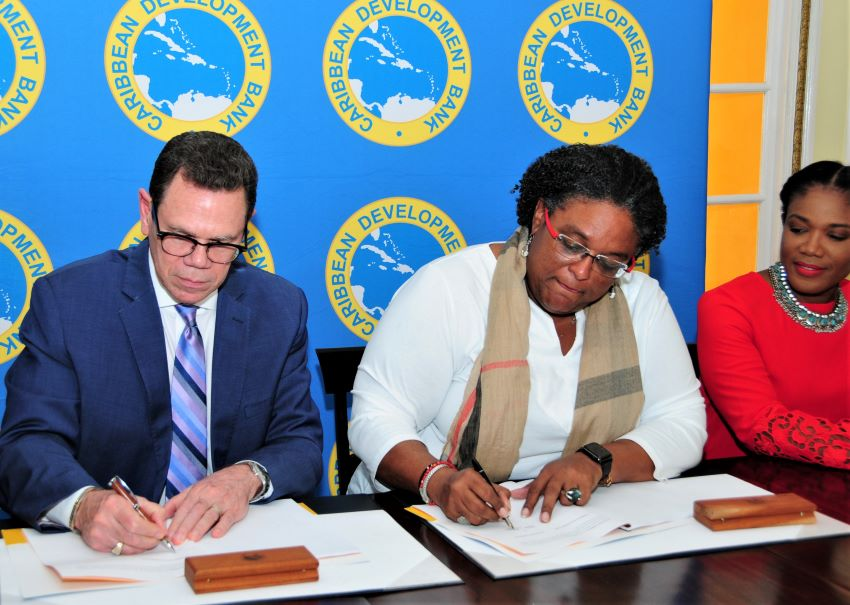 PM Mottley and CDB President, Dr. Warren Smith, signing a loan agreement for the second Programmatic Fiscal Sustainability Growth and Social Protection Policy Based Loan
