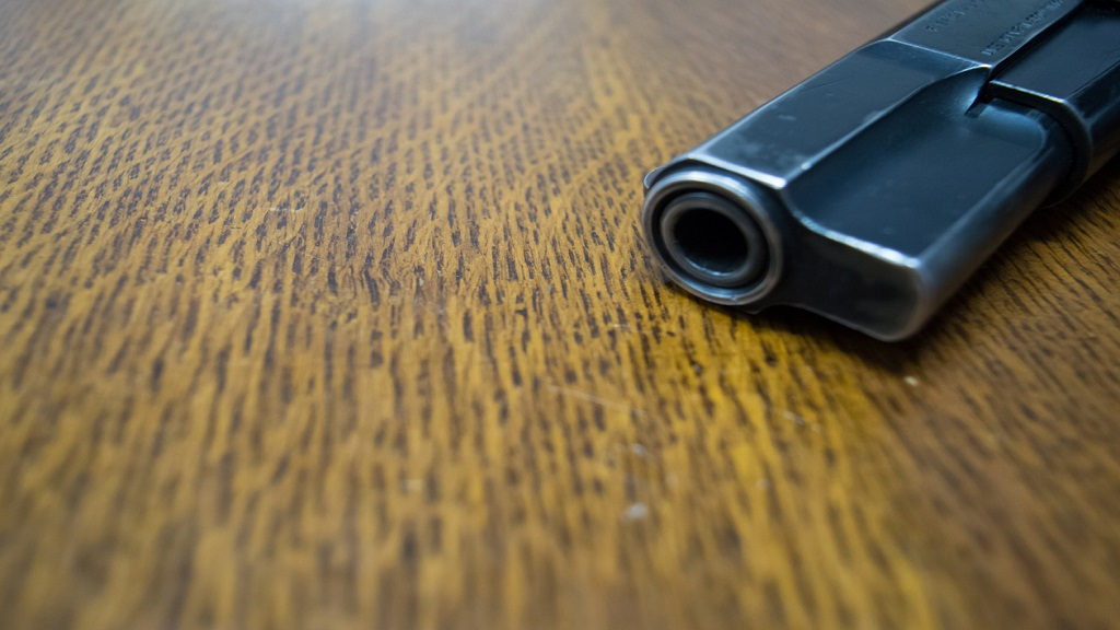 Stock image of a 9mm gun on a table. (Photo: iStock)