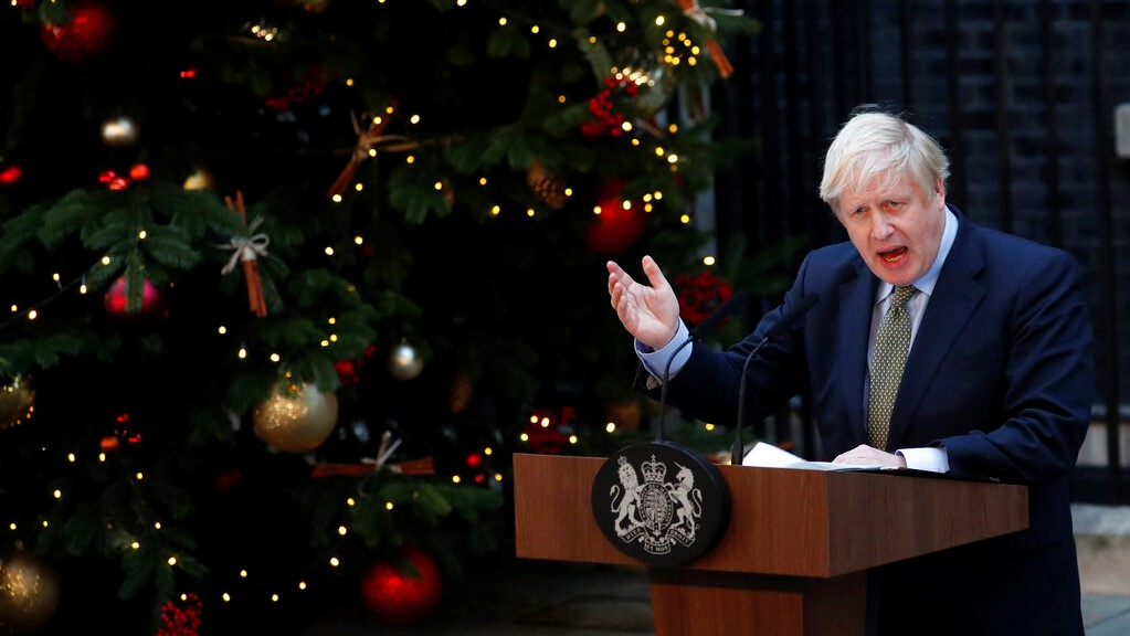 Britain's Prime Minister Boris Johnson addresses the media outside 10 Downing Street in London, Friday, Dec. 13, 2019. (AP Photo/Frank Augstein)