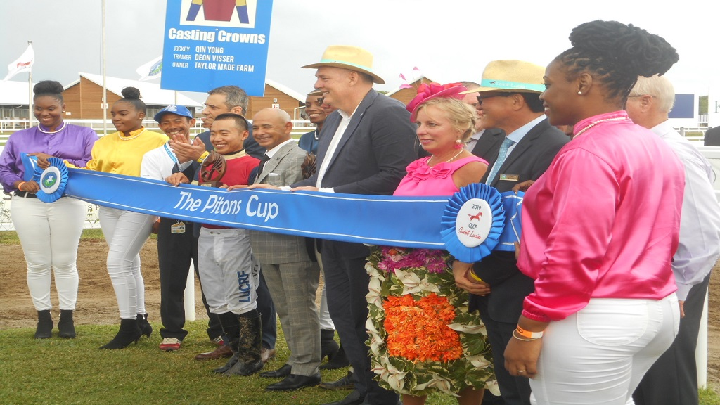 The Pitons Cup:  Jockey Qin Yong with his trophy, Prime Minister Allen Chastanet (centre) and other members of the winning connection.