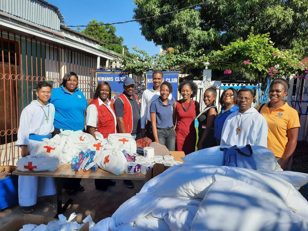 Jamaica Red Cross HR Manager Donna Thomas (third left), Kiwanis Club of West St. Andrew's President Marie Brown (centre), Kiwanis Club of Stony Hill President Latoya Latibeaudiere (fifth right), along with other volunteers  and two missionaries, display the  donated items. Kiwanis Club of West St. Andrew's PR Chairman Marshalyn Rose is at right.