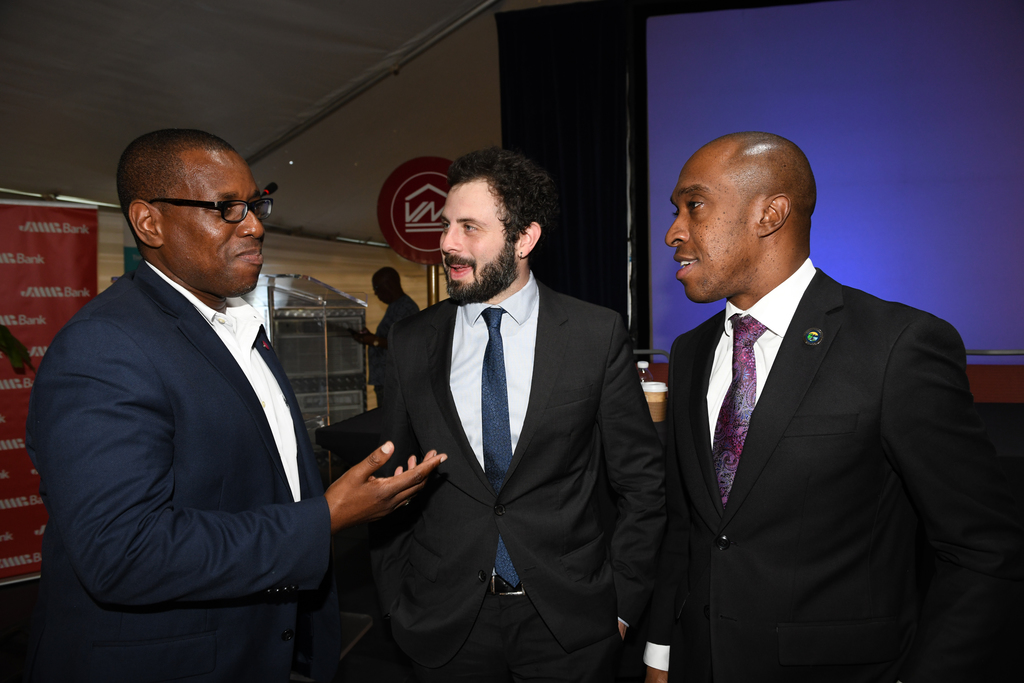 Paul Elliott (left), Vice President, Sales & Service, Victoria Mutual Building Society, engages in conversations with fellow presenter, Professor David Wachsmuth (centre), Assistant Professor, McGill University and Dr. Andrew Spencer Executive Director TPDCO, at the International Realtors Conference & Expo on December 5, 2019 at the Hilton Rose Hall Resort, in St James.