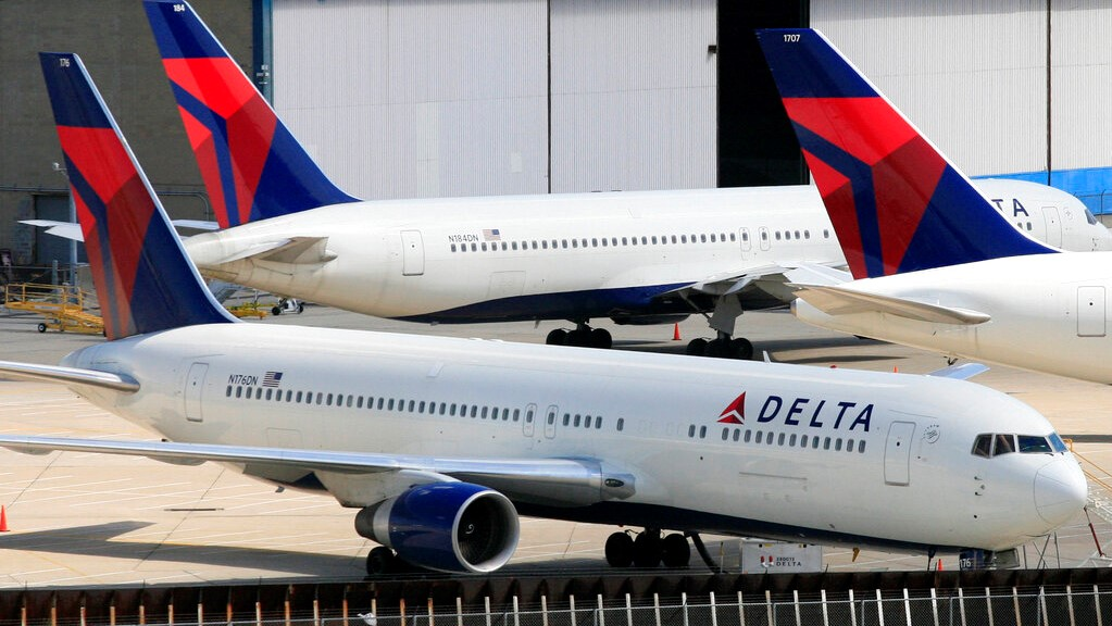In this April 20, 2010 file photo, Delta Air Lines jets are parked at John F. Kennedy International Airport, in New York. (AP Photo/Mark Lennihan)