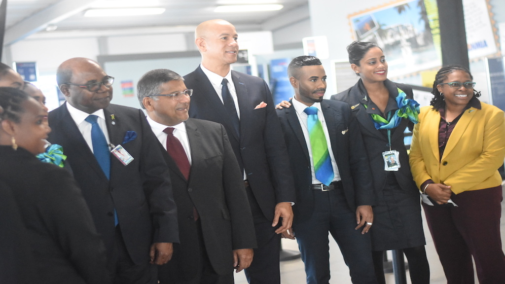 High Commissioner of the United Kingdom to Jamaica, Asif Ahmad (second left) and Tourism Minister Edmund Bartlett (left) joined Caribbean Airlines (CAL) the airline's board director Zachary Harding (centre); Dionne Ligoure (right), head of corporate communications at CAL and other members of the CAL team at the launch of the airline's service between Kingston and Grand Cayman. (Photo: Marlon Reid)