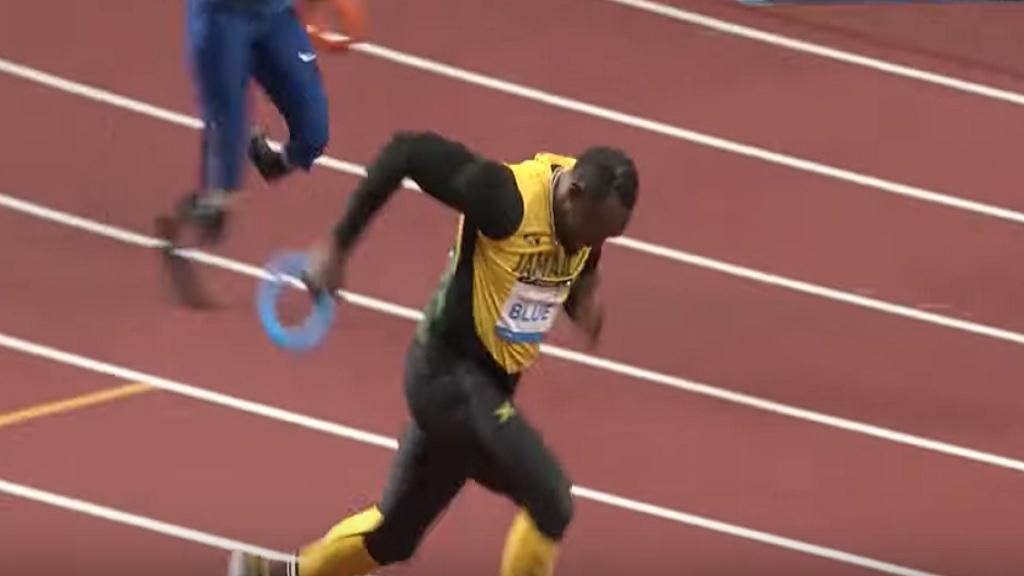 Usain Bolt of Jamaica, runs a lap in the Tokyo 2020 stadium opening.