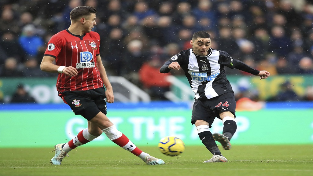 Newcastle United's Miguel Almiron, right, shoots towards goal, during the English Premier League football match against Southampton, at St James' Park, in Newcastle, England, Sunday, Dec. 8, 2019. (Owen Humphreys/PA via AP).