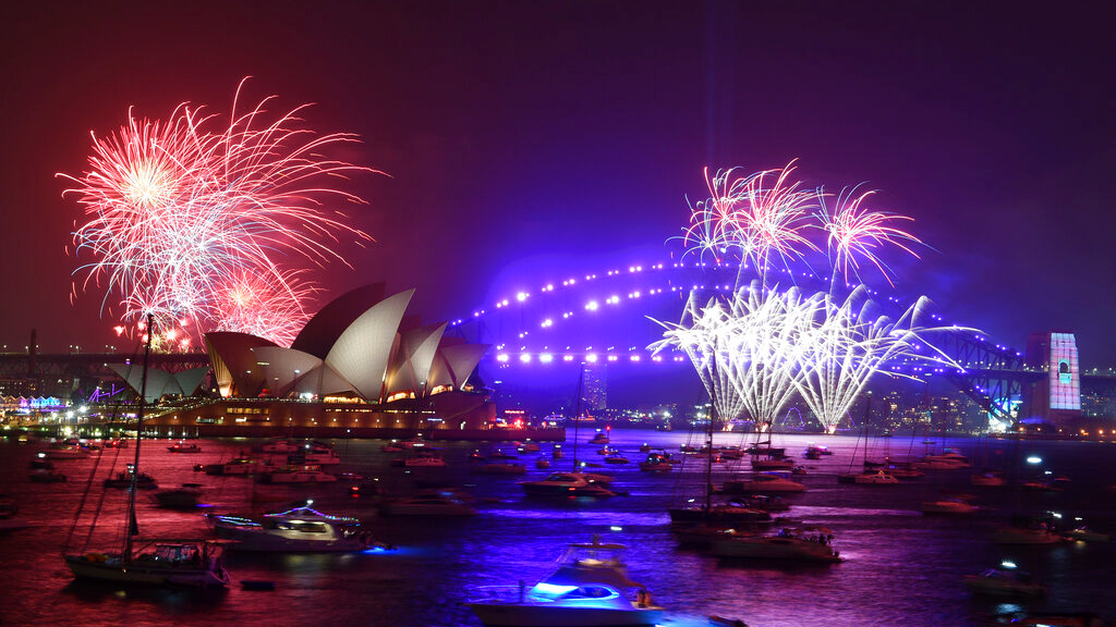 Fireworks are seen from Mrs. Macquarie's Chair during New Year's Eve celebrations in Sydney, Tuesday, December 31, 2019. (Mick Tsikas/AAP Image via AP)