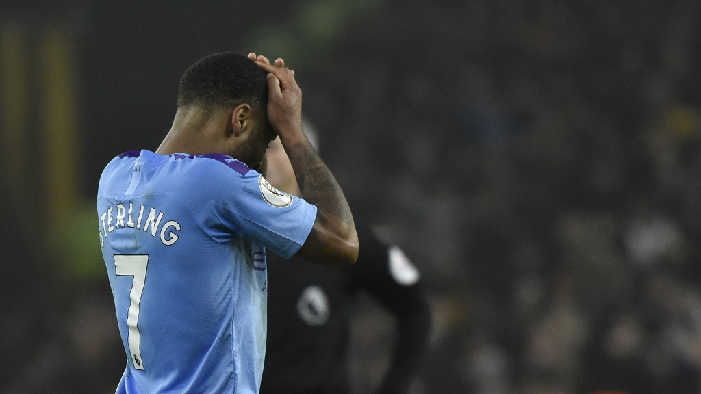 Manchester City's Raheem Sterling touches his face at the end of an English Premier League football match against Wolverhampton Wanderers at the Molineux Stadium in Wolverhampton, England, Friday, Dec. 27, 2019. Wolverhampton Wanderers won 3-2. (AP Photo/Rui Vieira).
