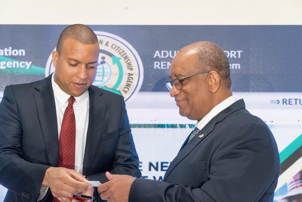 Scotiabank's Perrin Gayle (left), Senior Vice President Corporate and Commercial Banking and Andrew Wynter, CEO of Passport, Immigration and Citizenship Agency at a the launch of PICA's new online service.