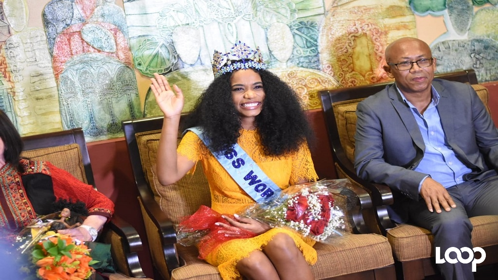 Miss World 2019, Toni-Ann Singh, acknowledges the cheers of those in attendance at a reception for her in the hospitality lounge at the Norman Manley International Airport in Kingston on her arrival home on Friday evening.