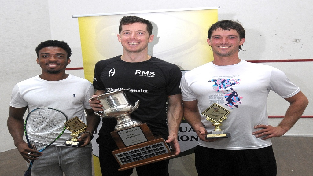 All Jamaica men's squash champion, Chris Binnie (centre) is flanked by runner-up Bruce Burrowes (right) and Tahjia Lumley, who placed third during the awards ceremony at the 2019 All Jamaica Squash Championships at the Liguanea Club in Kingston.