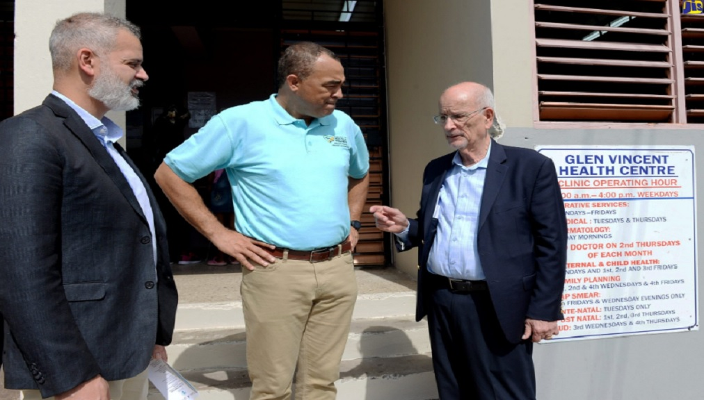 Health and Wellness Minister, Dr Christopher Tufton (centre), and Vice President of Business Development, Seaford Pharmaceuticals Inc., Andrew Seales (left), listen to a point being made by the Canadian-based company's Founder and Chief Executive Officer, Ron Seales.