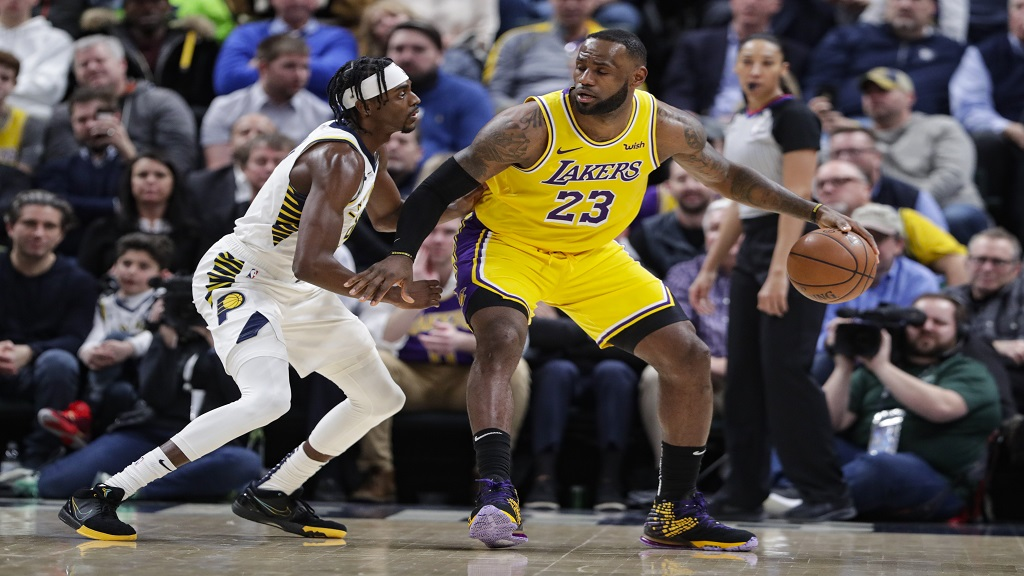 Indiana Pacers centre Myles Turner (33) defends Los Angeles Lakers forward LeBron James (23) during the second half of an NBA basketball game in Indianapolis, Tuesday, Dec. 17, 2019. The Pacers defeated the Lakers 105-102. (AP Photo/Michael Conroy).