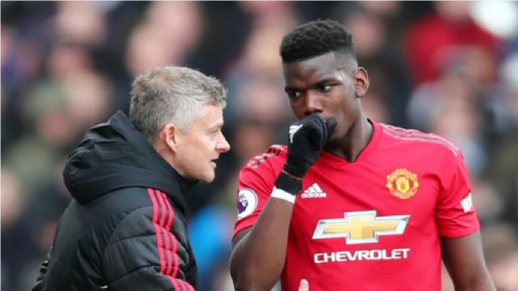 Manchester United manager Ole Gunnar Solskjaer and midfielder Paul Pogba.