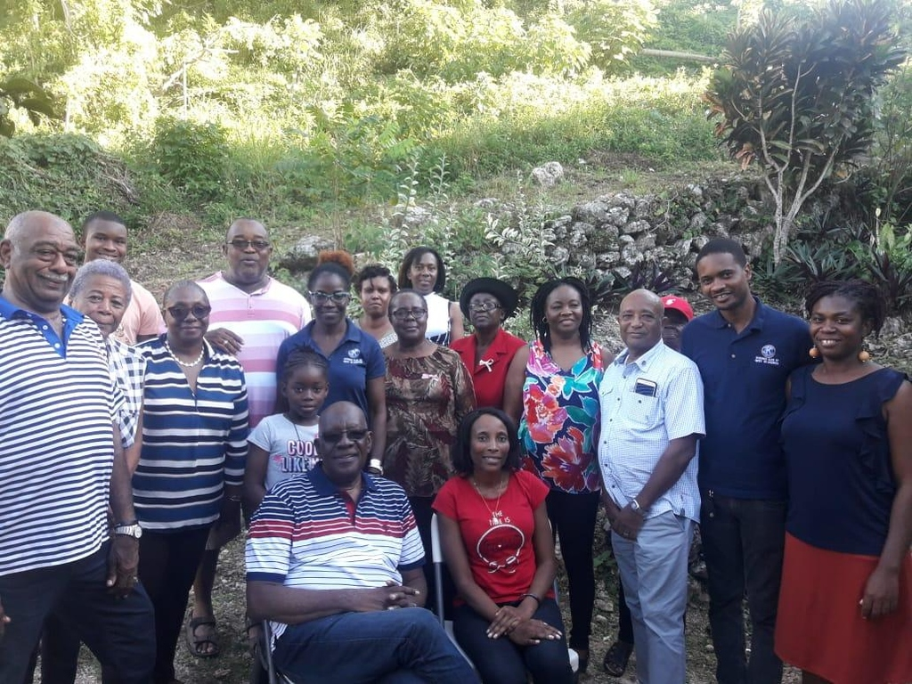 KCWSA President Marie Brown and Distinguished President Roy Townsend (sitting) share a group photo with club members and some Red Hills Golden-Agers Citizens Association representatives.