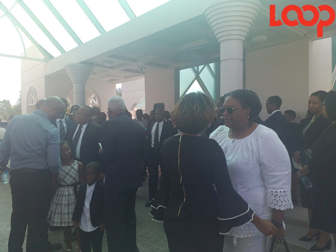 Prime Minister Mia Mottley (in white) and members of Cabinet console family and friends at the end of the funeral service.