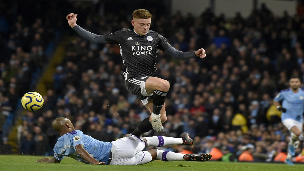 Manchester City's Fernandinho tackles Leicester's Harvey Barnes during the English Premier League football match against Leicester City at Etihad stadium in Manchester, England, Saturday, Dec. 21, 2019. (AP Photo/Rui Vieira).