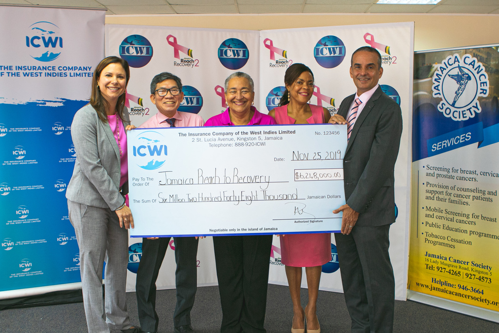 President of ICWI, Paul Lalor (right) is joined by the company's VP Marketing, Distribution & HR, Samantha Samuda (left) and VP Investments, Strategic Planning and Information Technology, Patrick Williams (second from left) during a (symbolic) cheque presentation to Chairperson of Jamaica Reach to Recovery (JRR), Carolind Graham (centre) and Executive Director of the Jamaica Cancer Society (JCS), Yulit Gordon, (second right).