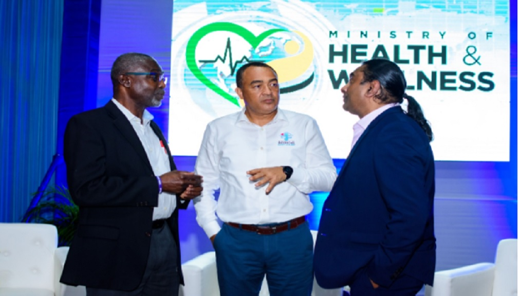 Professor Rubin Pillay (right) Assistant Dean, Global Health Innovation at the School of Medicine at the University of Alabama in Birmingham, engages Health and Wellness Minister Dr Christopher Tufton (centre) and Professor Emeritus Rainford Wilks during the launch of the Research For Wellness Fund.