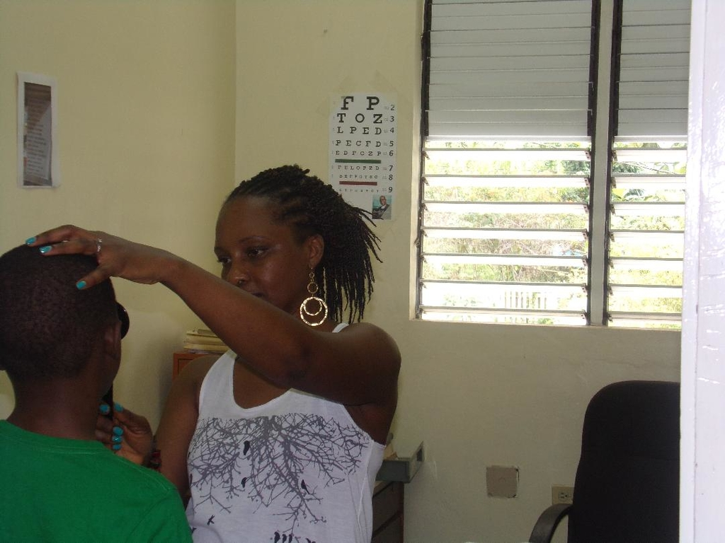Optometrist Dr Romea Mitchell conducts an eye examination on one of the children.