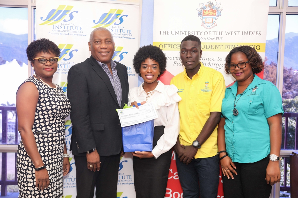 L-R: Darlene Jones, Executive Director of Jamaica Institute of Financial Services (JIFS), Dr Rickert Allen, Jamaica Institute of Financial Services (JIFS) Chairman, Tajae Alexander, Learning Grant 2019/2020 awardee, Mr. Daniel Levy, President of the UWI Banking League, Marsha-Gaye Lawrence, representing the Office of Student Financing.