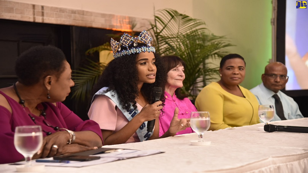 Miss World 2019, Toni-Ann Singh (2nd left), responds to questions at a press conference at the Jamaica Pegasus Hotel in New Kingston on December 21. Looking on (from left) are Minister of Culture, Gender, Entertainment and Sport, Olivia Grange; Chairman and Chief Executive Officer of the Miss World Organisation, Julia Morley; and Singh's parents, Jahrine Bailey and Bradshaw Singh.