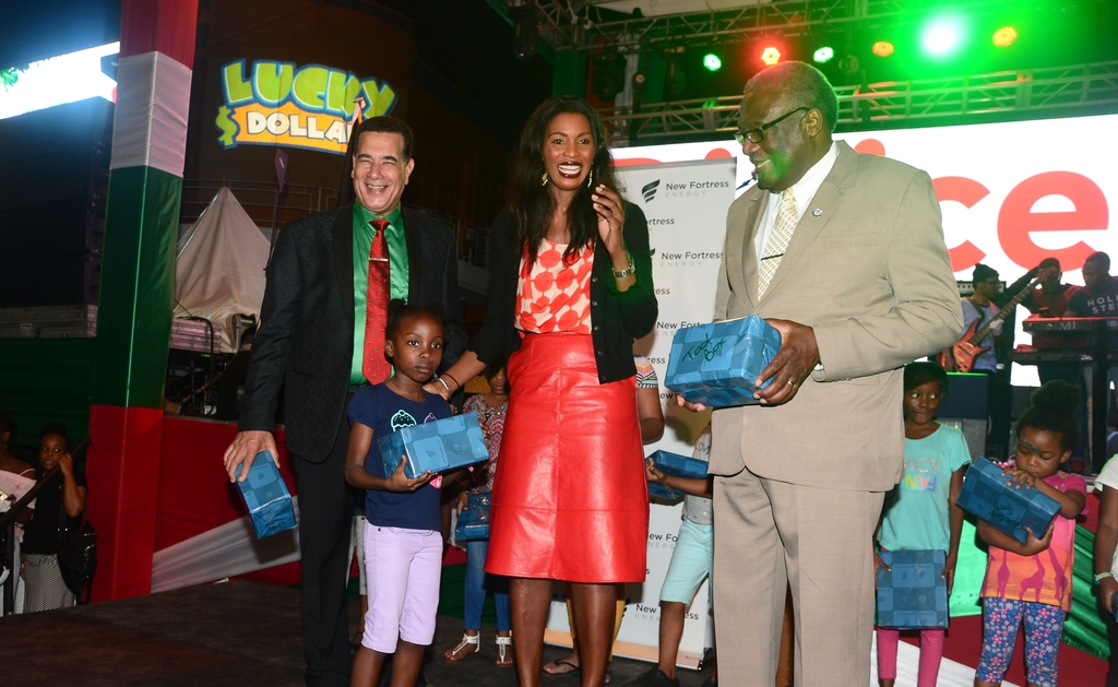 These kids were excited to get their Christmas gifts courtesy of New Fortress Energy during the 2018 staging of the annual Christmas Tree Lighting Ceremony in Sam Sharpe Square in St James.