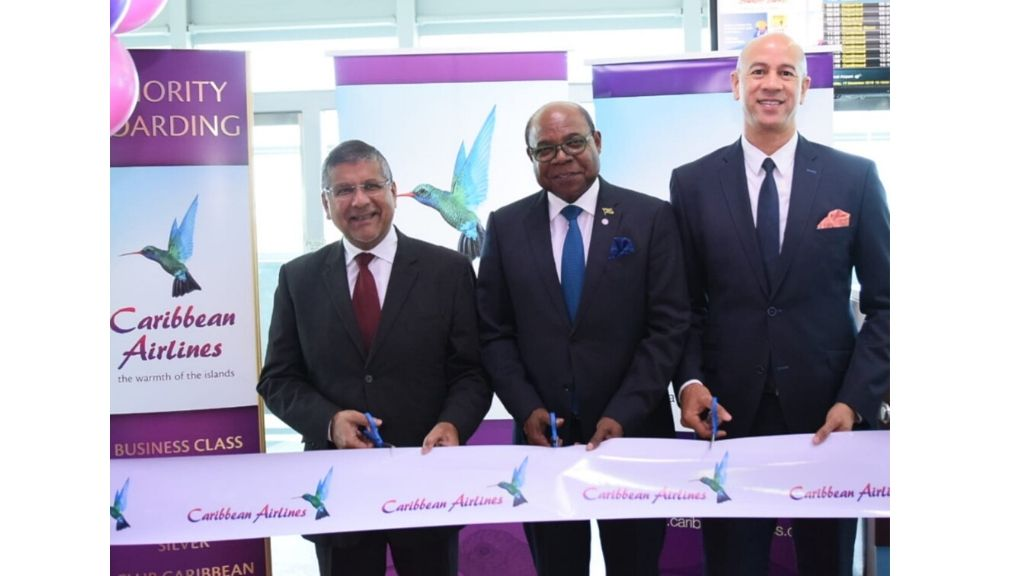 L-R: High Commissioner of the United Kingdom to Jamaica, Asif Ahmad, the Minister of Tourism for Jamaica, the Honourable Edmund Bartlett and Zachary Harding, Director Caribbean Airlines