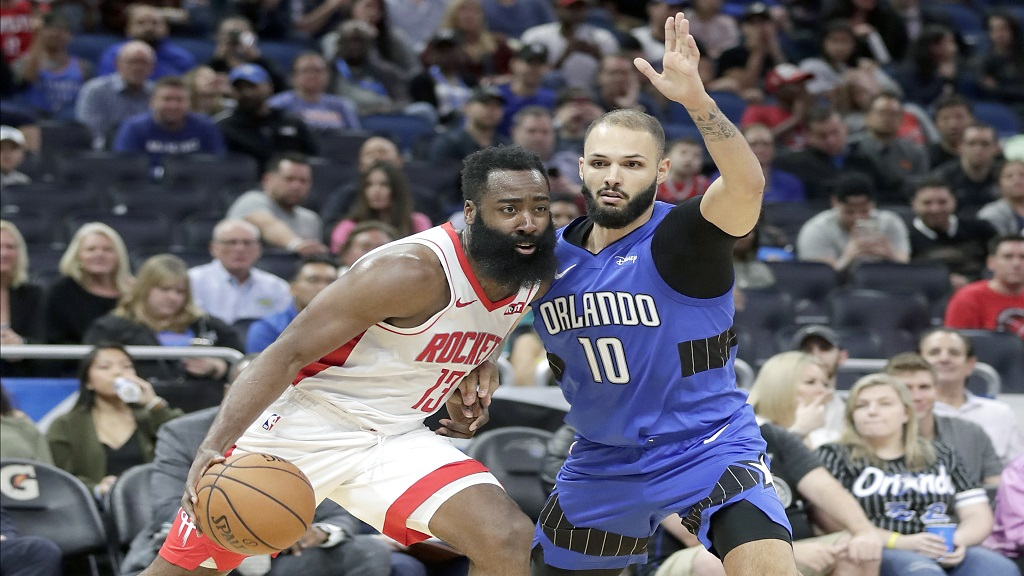 Houston Rockets guard James Harden, left, drives around Orlando Magic guard Evan Fournier (10) during the first half of an NBA basketball game, Friday, Dec. 13, 2019, in Orlando, Fla. (AP Photo/John Raoux).