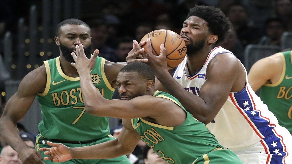 Philadelphia 76ers center Joel Embiid controls the ball against Boston Celtics guards Kemba Walker (8) and Jaylen Brown (7) in the second half of an NBA basketball game, Thursday, Dec. 12, 2019, in Boston. The 76ers won 115-109. (AP Photo/Elise Amendola).