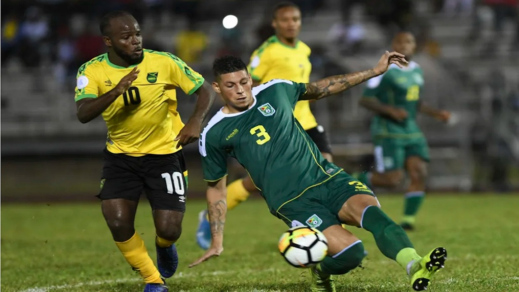 Javon East (left) of Jamaica challenges Matthew Briggs (right) of Guyana during their Group C of League B fixture of the Concacaf Nations League at the Montego Bay Sports Complex on Monday, November 18, 2019. (PHOTO: Concacaf).