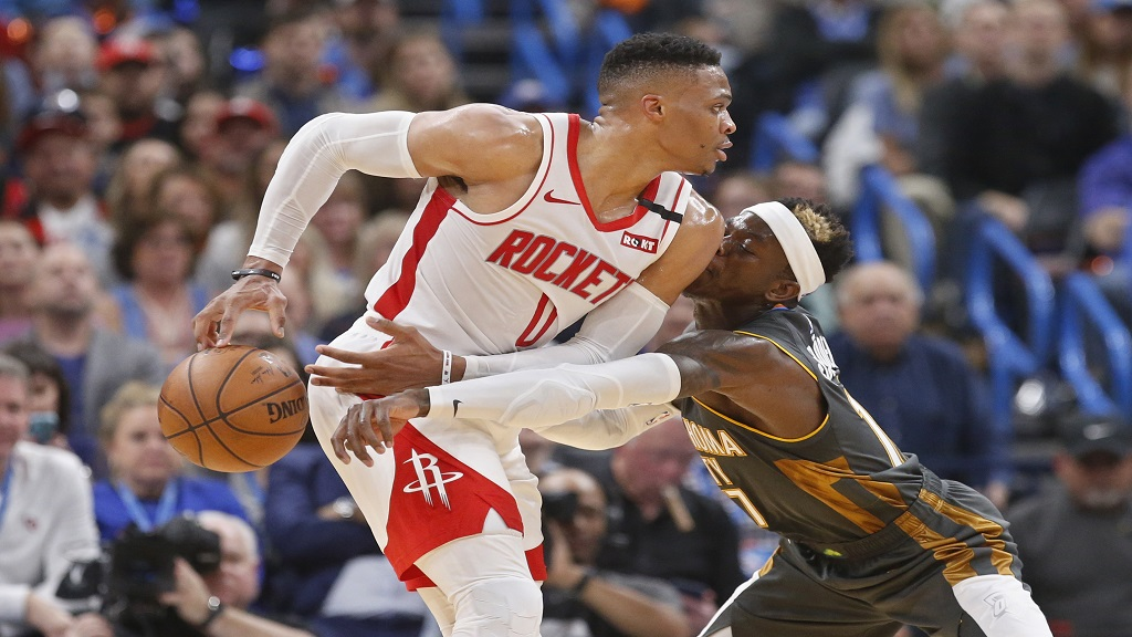 Oklahoma City Thunder guard Dennis Schroeder (17) knocks the ball away from Houston Rockets guard Russell Westbrook (0) during the first half of an NBA basketball game Thursday, Jan. 9, 2020, in Oklahoma City. (AP Photo/Sue Ogrocki).