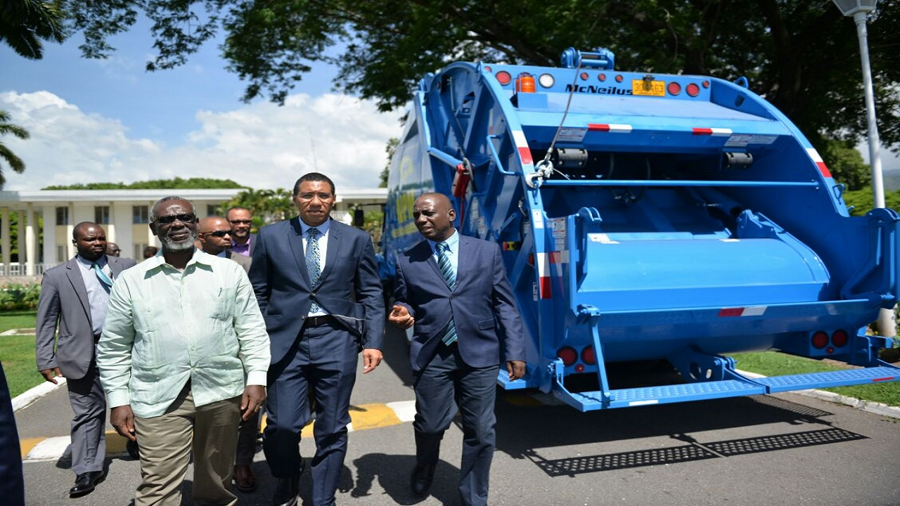 The acquisition and presentation of new garbage trucks at a point over recent years.