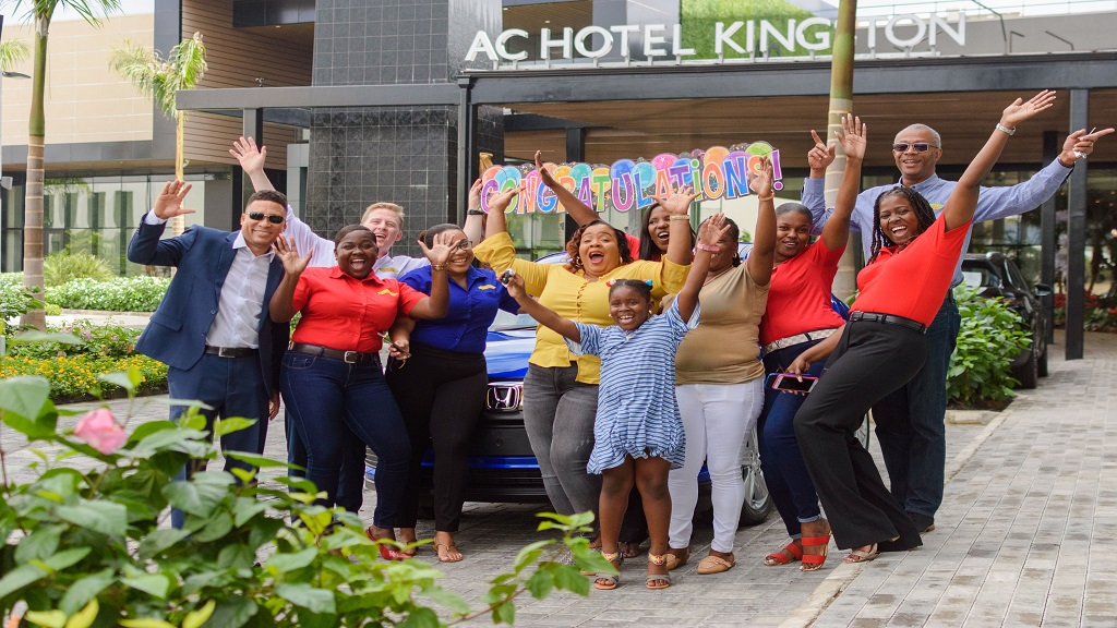 Rochelle Wellington (centre) celebrating her brand new 2020 Honda HR-V with her daughter alongside the Rainforest and ATL Automotive teams at the AC Mariott Hotel on Saturday, December 14.