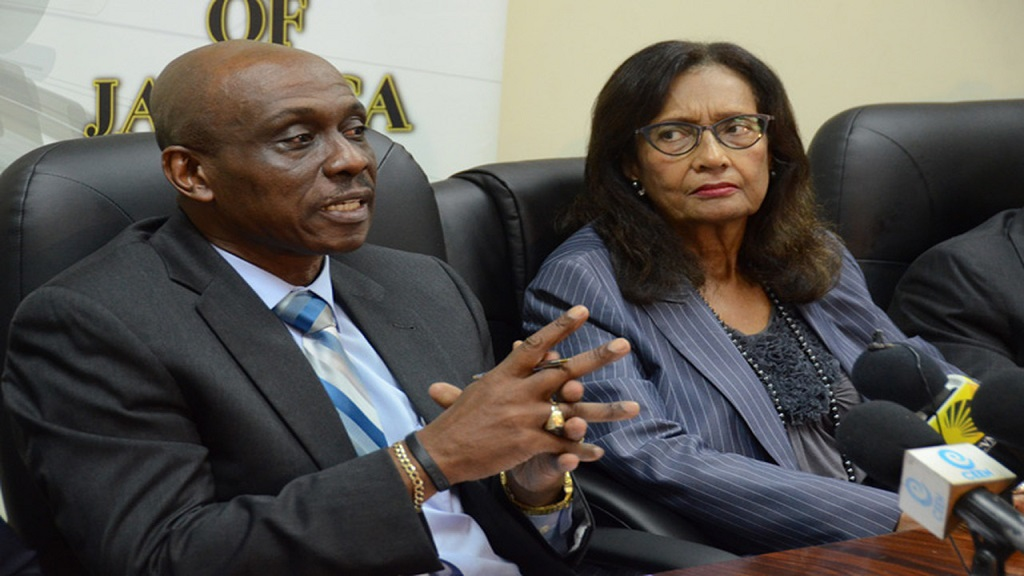A file photo of now outgoing Electoral Commission of Jamaica (ECJ) Chairman, Dorothy Pine-McLarty, and former Director of Elections, Orette Fisher, at an official function.