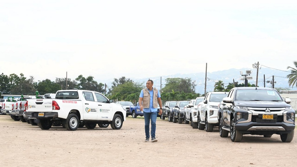 Minister of Health and Wellness, Dr Christopher Tufton, takes a look at some of the vehicles being used in the fight against dengue, at a handover cerermony held at the Ranny Williams Entertainment Centre in St Andrew on Monday. (Photos: Marlon Reid)
