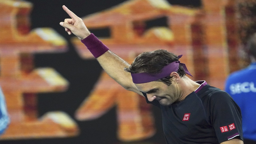 Switzerland's Roger Federer celebrates after defeating Australia's John Millman in their third round match at the Australian Open tennis championship in Melbourne, Australia, Saturday, Jan. 25, 2020.(AP Photo/Lee Jin-man).
