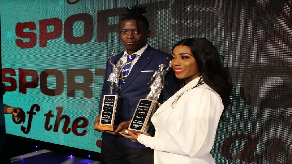 Tajay Gayle (left) and Shelly-Ann Fraser-Pryce pose with the Sportsman and Sportswoman of the Year awards at the gala ceremony at the Jamaica Pegasus Hotel on Friday, January 17, 2020. (PHOTOS: Llewellyn Wynter).