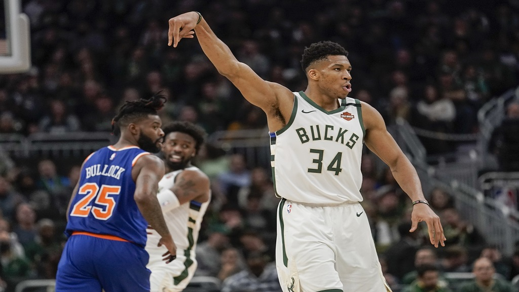 Milwaukee Bucks' Giannis Antetokounmpo reacts to his three-point basket during the second half of an NBA basketball game against the New York Knicks Tuesday, Jan. 14, 2020, in Milwaukee. (AP Photo/Morry Gash).