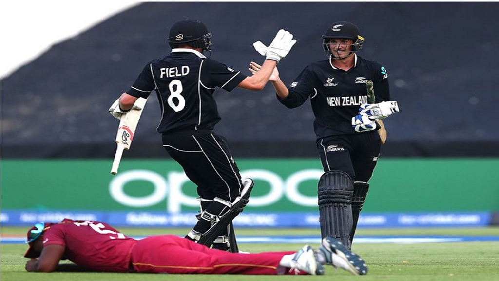 New Zealand batsmen  Joey Field (left) and Kristian Clarke celebrate victory against West Indies.