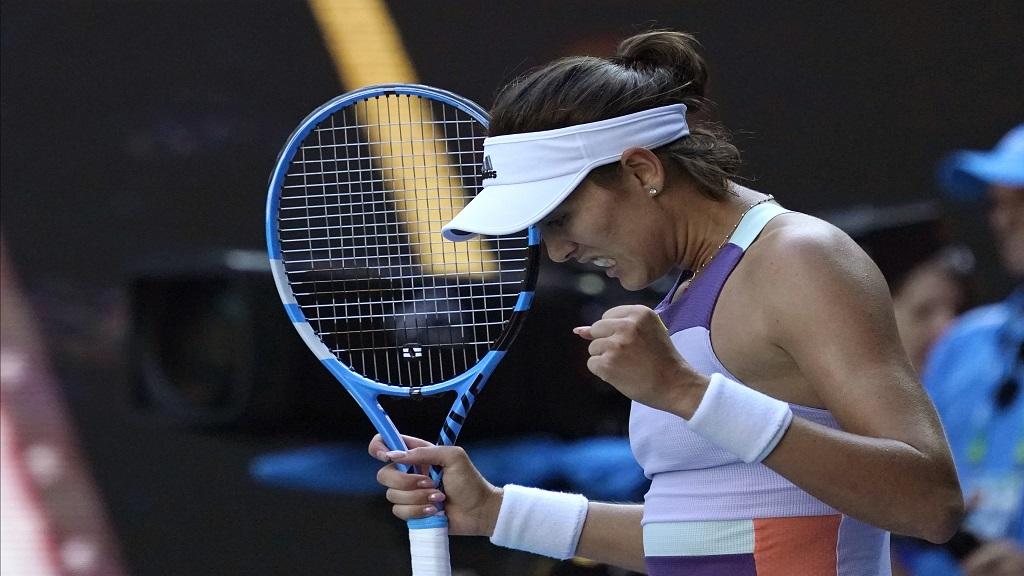 Spain's Garbine Muguruza celebrates after defeating Romania's Simona Halep during their semifinal match at the Australian Open tennis championship in Melbourne, Australia, Thursday, Jan. 30, 2020.(AP Photo/Lee Jin-man).