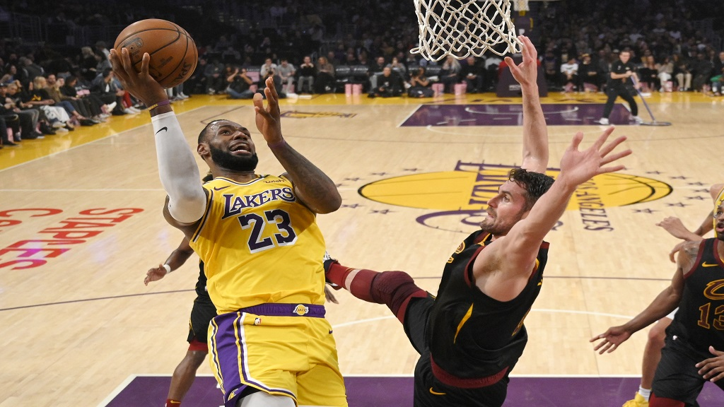 Los Angeles Lakers forward LeBron James, left, shoots as Cleveland Cavaliers forward Kevin Love defends during the first half of an NBA basketball game Monday, Jan. 13, 2020, in Los Angeles. (AP Photo/Mark J. Terrill).