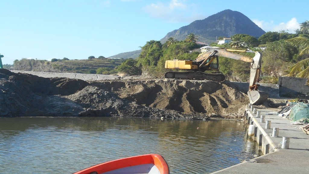 Desilting underway at the Choiseul Fishing Port to make it accessible to boats
