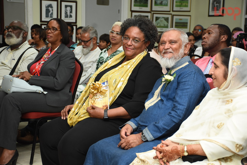 Prime Minister Mia Mottley and author Sabir Nakhuda