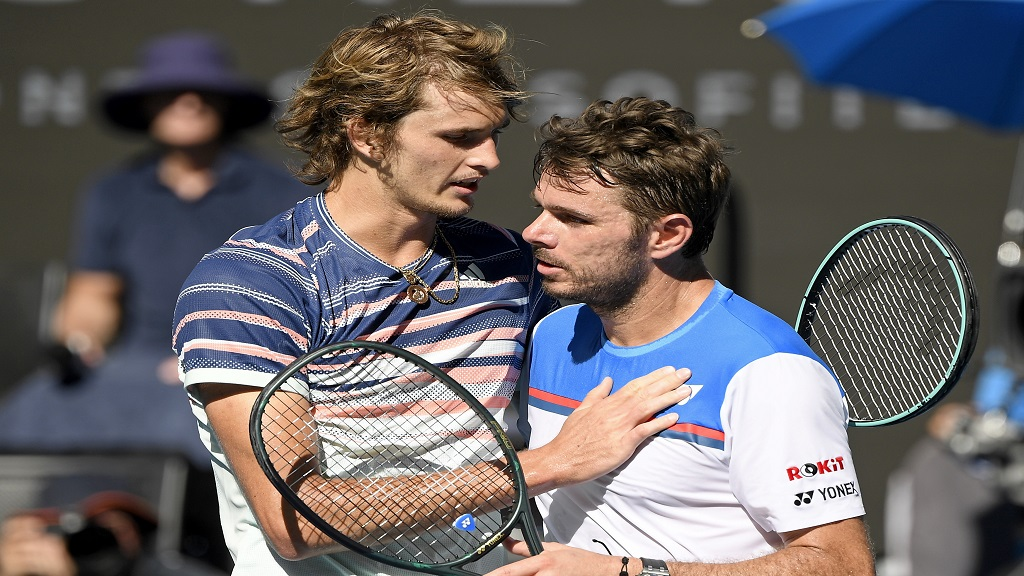 Germany's Alexander Zverev, left, is congratulated by Switzerland's Stan Wawrinka after winning their quarterfinal match at the Australian Open tennis championship in Melbourne, Australia, Wednesday, Jan. 29, 2020. (AP Photo/Andy Brownbill).