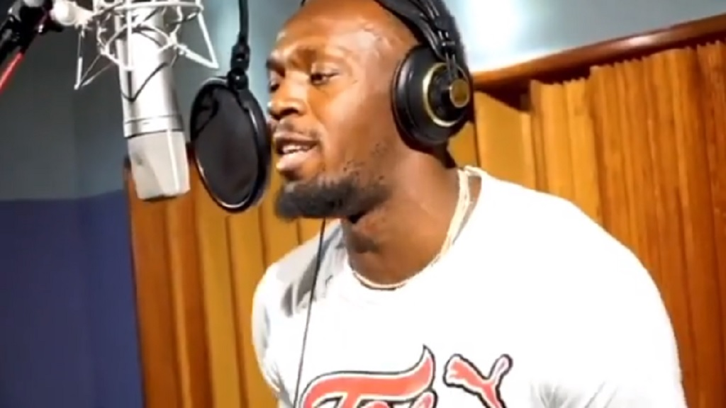 Screengrab of a video posted to Usain Bolt's Instagram page shows the retired athlete recording his new soca song in a studio.