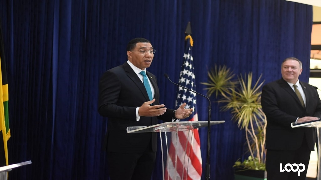 Jamaica's Prime Minister Andrew Holness (left) addresses journalists at a press conference at the Office of the Prime Minister on Wednesday morning, while US Secretary of State Mike Pompeo looks on. (Photos: Marlon Reid)