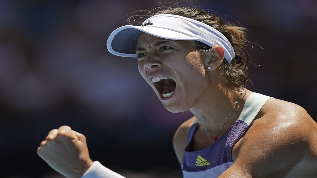 Spain's Garbine Muguruza reacts after winning the first set against Russia's Anastasia Pavlyuchenkova during their quarterfinal match at the Australian Open tennis championship in Melbourne, Australia, Wednesday, Jan. 29, 2020. (AP Photo/Lee Jin-man).